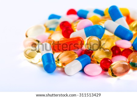 Pills in the flask, vials and the tubes with medications on white background