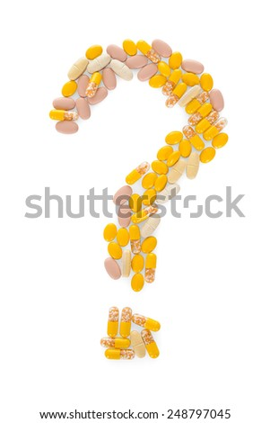 Pills In The Shape Of A Question Mark Over White Background - stock photo