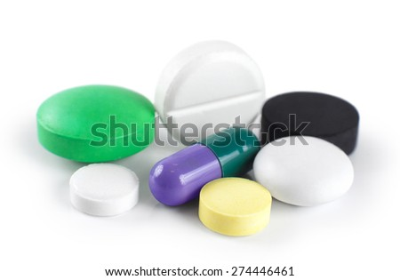 Pills isolated on white background. Macro.
