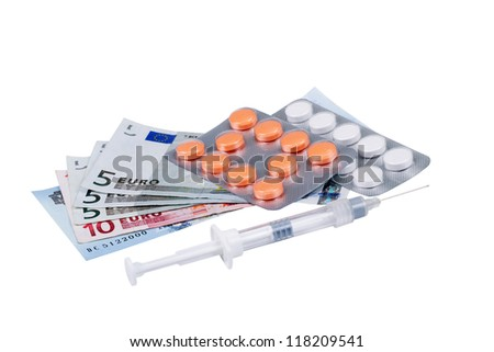 Pills of different colors on money background representing rising health care costs - stock photo