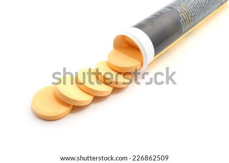 Pills of vitamin C on white background - stock photo