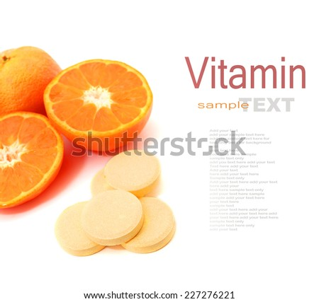 Pills of vitamin C with oranges on white background - stock photo