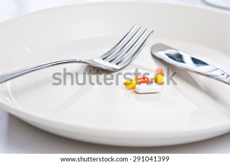 pills on a plate - stock photo