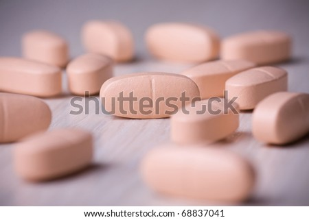 Pills on a wooden table