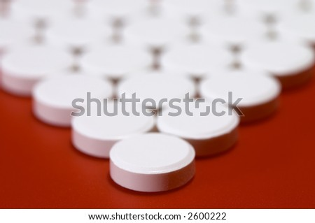 Pills on red background. Shallow DOF