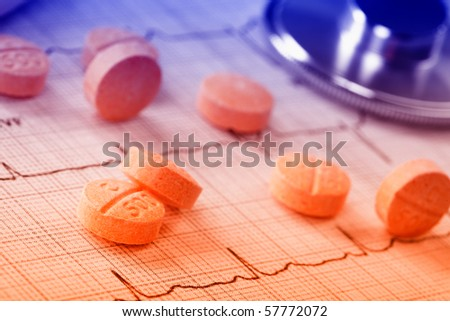 pills on the cardiogram - stock photo
