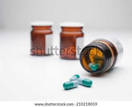 Pills over white background, for medicine,healthcare,addiction themes - stock photo