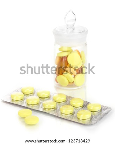 Pills packed in blister and receptacle isolated on white - stock photo