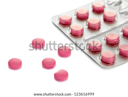 pills packed in blisters, isolated on white - stock photo