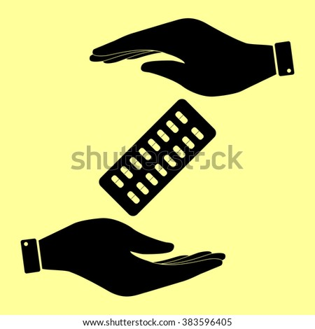Pills sign. Save or protect symbol by hands. - stock photo