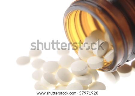 Pills spilling - stock photo