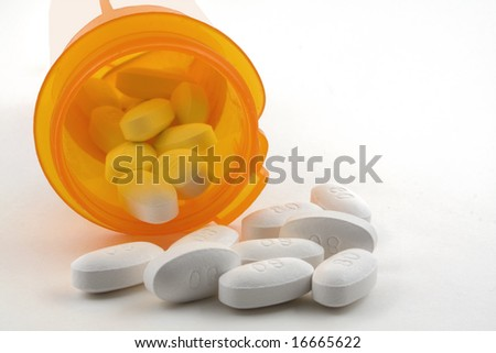Pills spilling out of a bottle