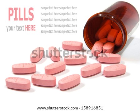 Pills spilling out of a pill bottle isolated on white background - stock photo
