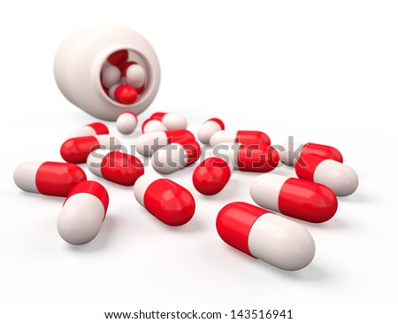 Pills spilling out of pill bottle isolated on white. - stock photo