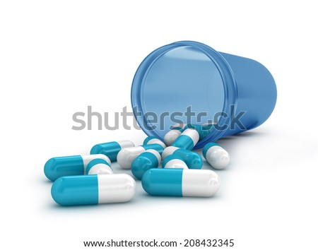 Pills spilling out of pill bottle isolated on white