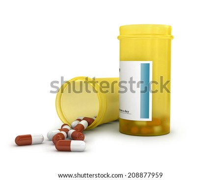 Pills spilling out of pill bottle isolated on white - stock photo