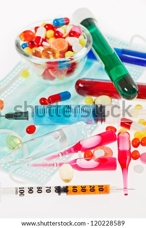 Pills, sterile mask, ampoules and syringe closeup still life,  medical concept - stock photo