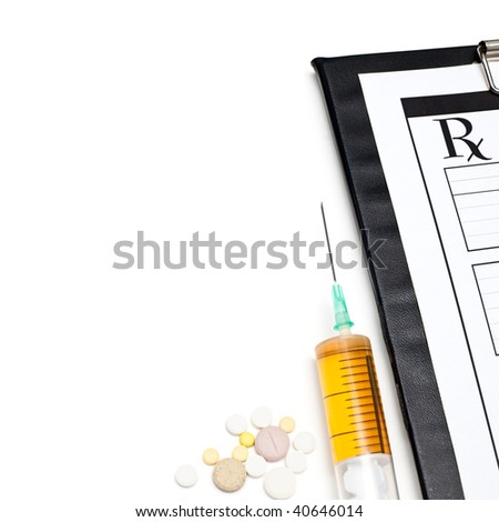 Pills syringe and clipboard on white background - stock photo
