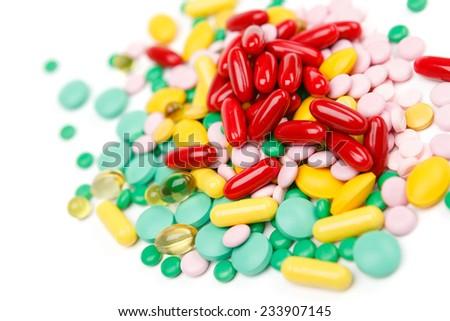 Pills vitamin supplement, on white background - stock photo