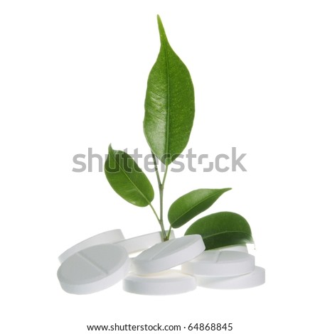 Pills with Leaf as Homeopathic Medicine Symbol on White - stock photo