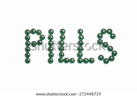 Pills written with green pills - white background - stock photo