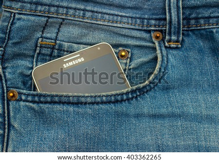 PILOS, GREECE, APR 10, 2016: Modern SAMSUNG GALAXY NOTE in a blue denim pocket - stock photo
