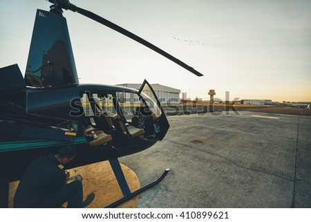 Pilot checking the condition of helicopter before take off. Pilot doing pre flight inspection. - stock photo