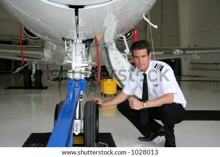 Pilot checking the gear of his business jet
