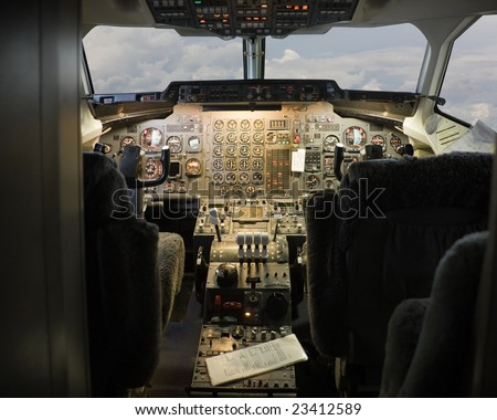 pilot cockpit in an passenger commercial airplane
