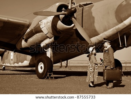 Pilot gives wife a red rose before flying off to war - stock photo