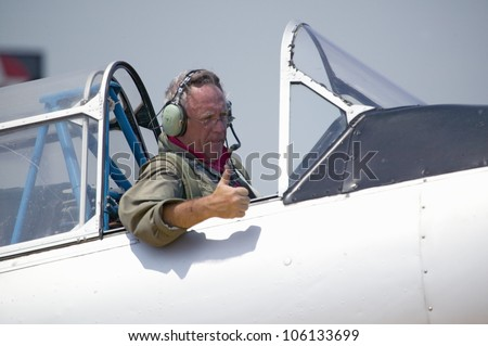 Pilot giving thumbs-up in his North American SNJ-4 � SNJ-6 fighter plane from World War II, Mid-Atlantic Air Museum World War II Weekend and Reenactment in Reading, PA held June 18, 2008 - stock photo