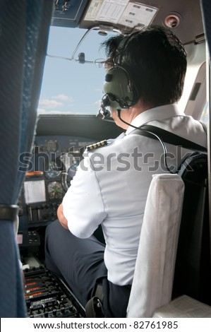 Pilot in a small plane cockpit preparing for Take-off - stock photo