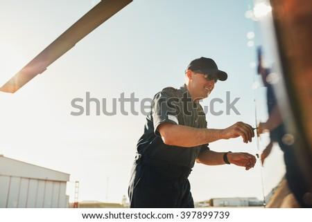 Pilot inspecting the helicopter before the flight. Mechanic doing pre flight inspection. - stock photo