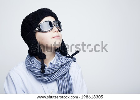 Pilot kid against gray background - stock photo