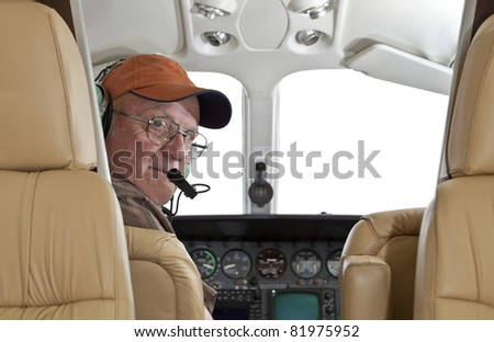 Pilot looking back at passenger compartment in a Cessna twin engine airplane - stock photo