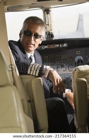Pilot sitting in a private airplane - stock photo