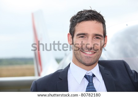 Pilot smiling - stock photo