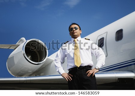 Pilot standing next to airplane