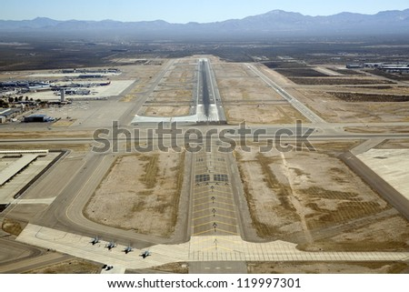 Pilot view of approach to landing at Tucson International Airport - stock photo