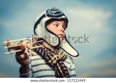 Pilot with plane on a background of the sky