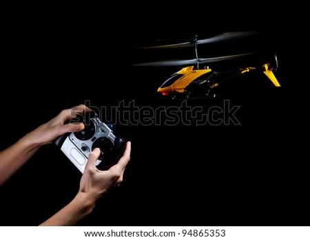 Piloting remote control helicopter - stock photo