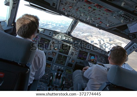 Pilots prepared aircraft for landing at the airport - stock photo