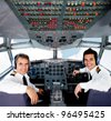 Pilots sitting in an airplane cabin flying on auto-pilot - stock photo