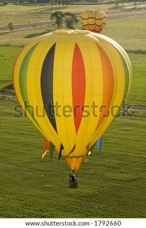 Pilots View of Hot Air Balloons over Fields - stock photo