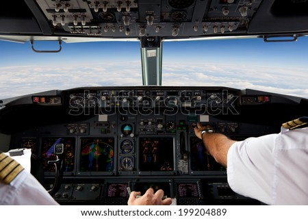 Pilots Working in an Aircraft During a Commercial Flight - stock photo