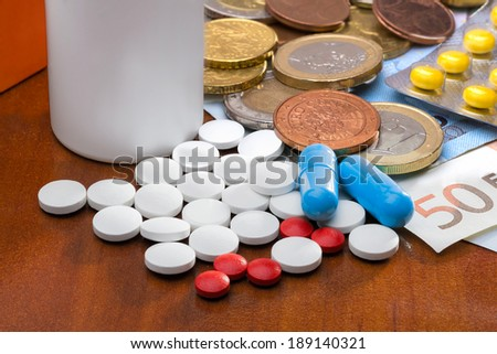 Pils and capsules with Euro money - stock photo
