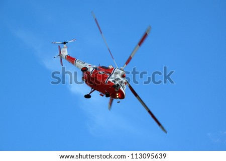 PILSEN, CZECH REPUBLIC - AUGUST 25: Modern rescue helicopter W-3A Sokol in flight on blue sky, Pilsen airshow on August 25, 2012 in Pilsen, Czech republic. - stock photo