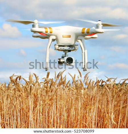PILSEN CZECH REPUBLIC - JUNE 26, 2016: Drone quadrocopter Dji Phantom 3 Professional with camera. Farmer use drone for inspect of crop on wheat fields. Modern technology in agriculture.