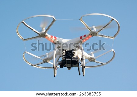 PILSEN, CZECH REPUBLIC - MARCH 19, 2015: Flying drone quadcopter Dji Phantom 2 with digital camera GoPro HERO4. - stock photo