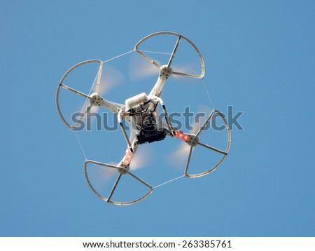 PILSEN, CZECH REPUBLIC - MARCH 19, 2015: Flying drone quadcopter Dji Phantom 2 with digital camera GoPro HERO4. - stock photo